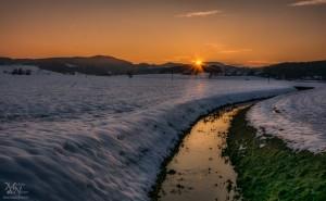Zimski sončni zahod pri Hrastovcu (v Slov.goricah)